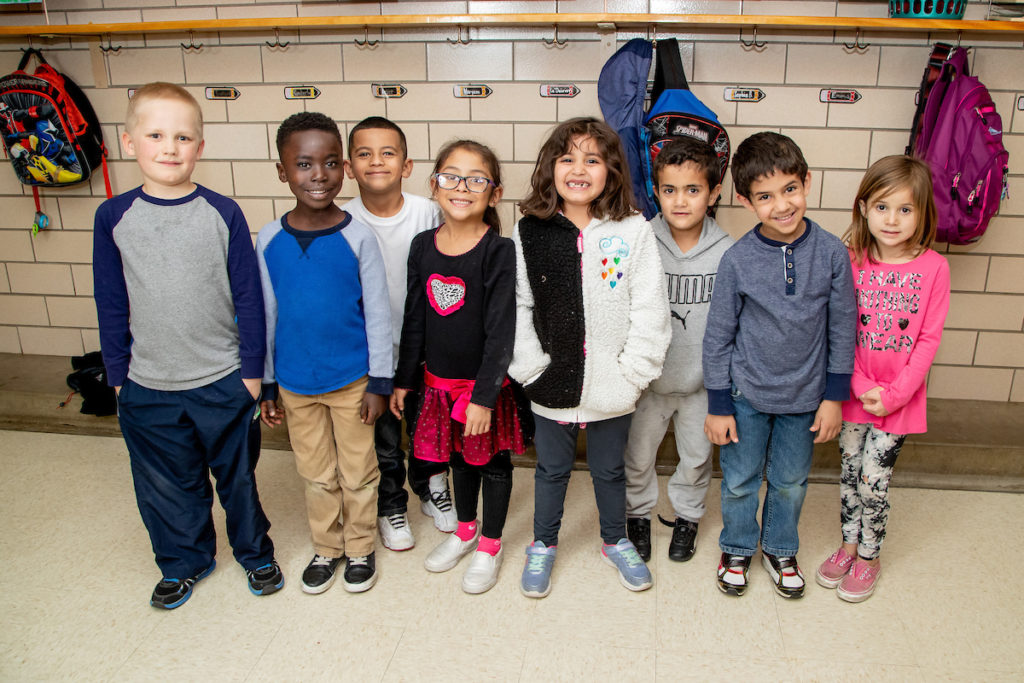 Elementary students standing in a group together